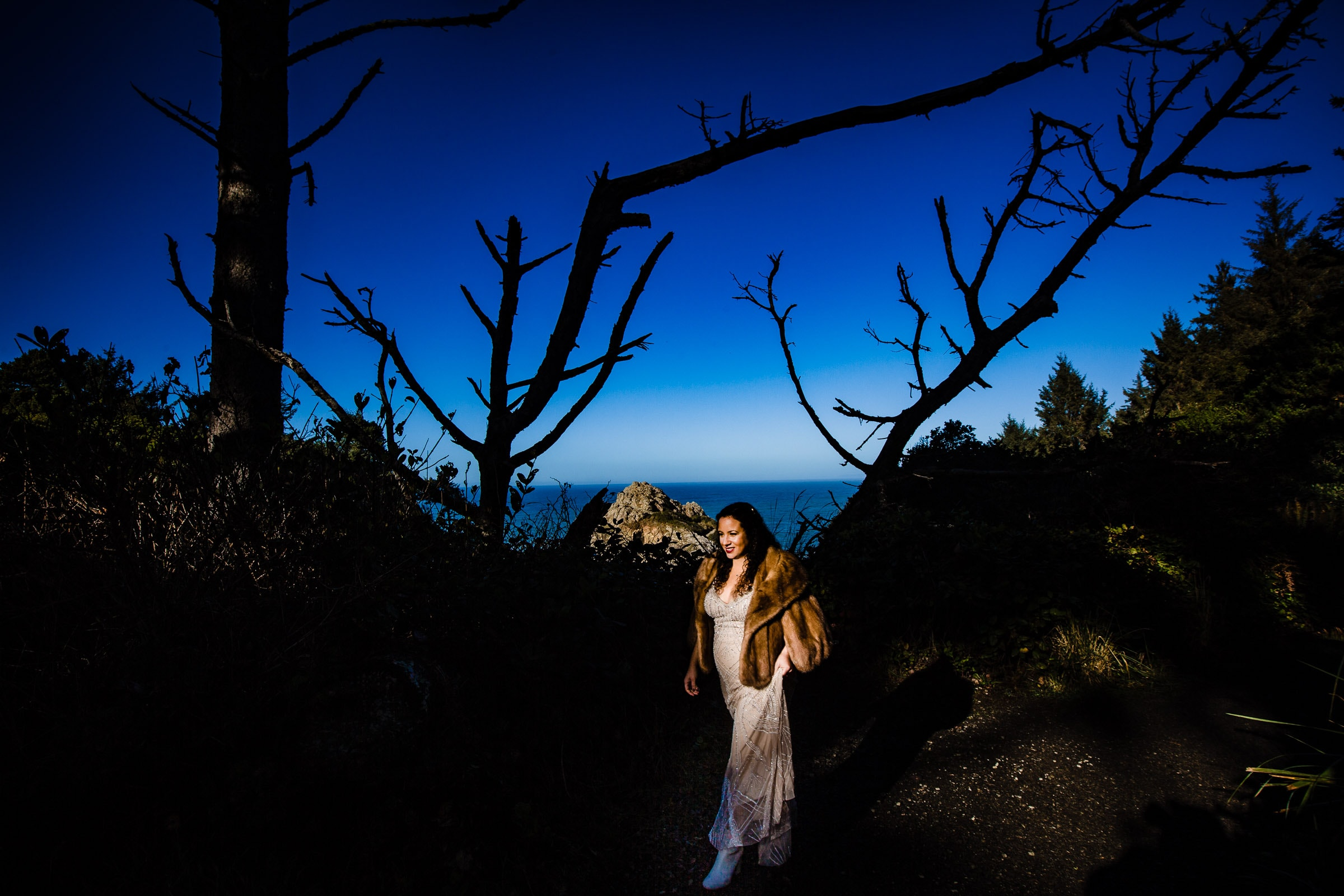 Bride walking into her Patricks Point elopement ceremony on Wedding Rock near Trinidad California
