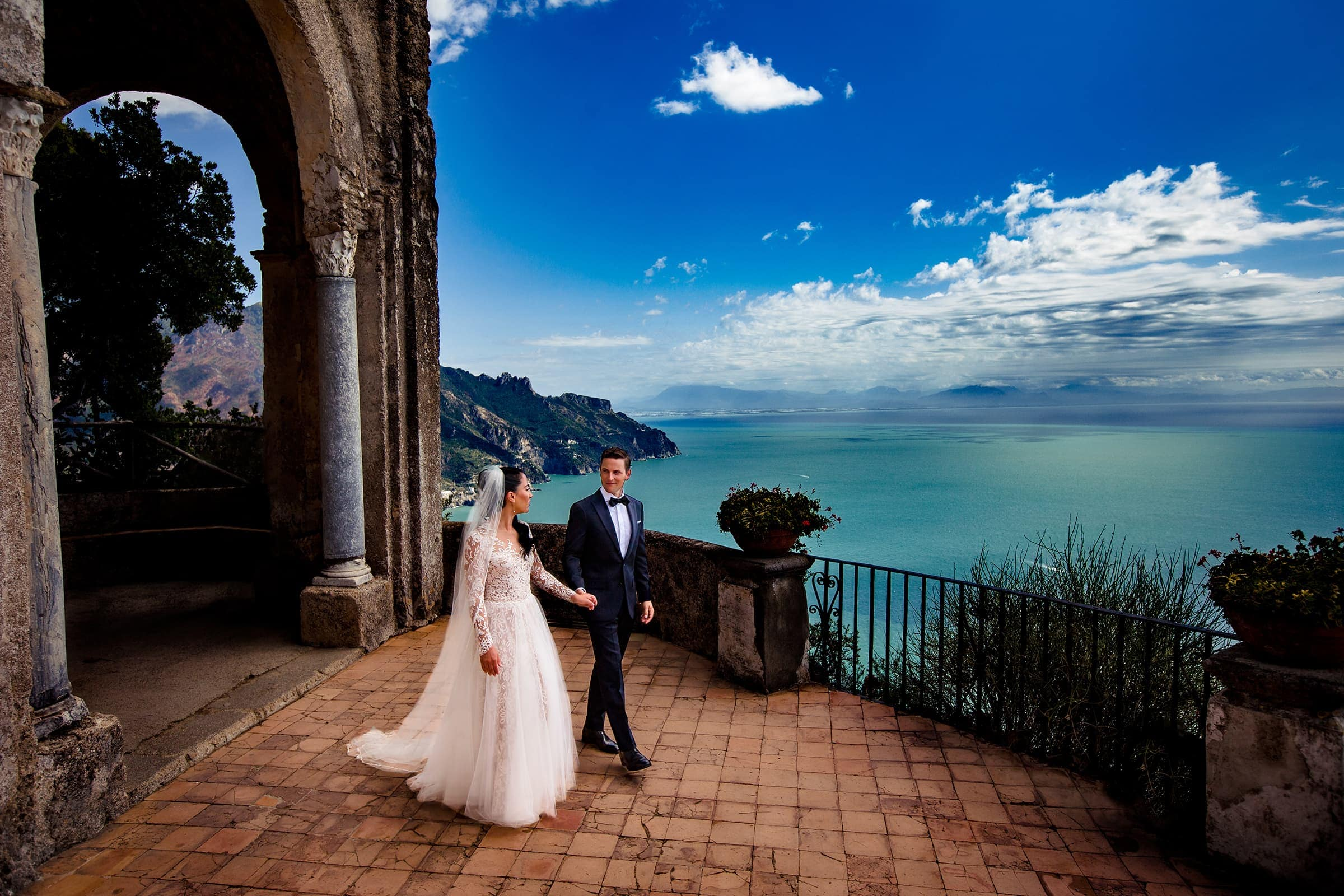 Couple walking in an epic elopement location called Villa Cimbrone in Ravello, Italy