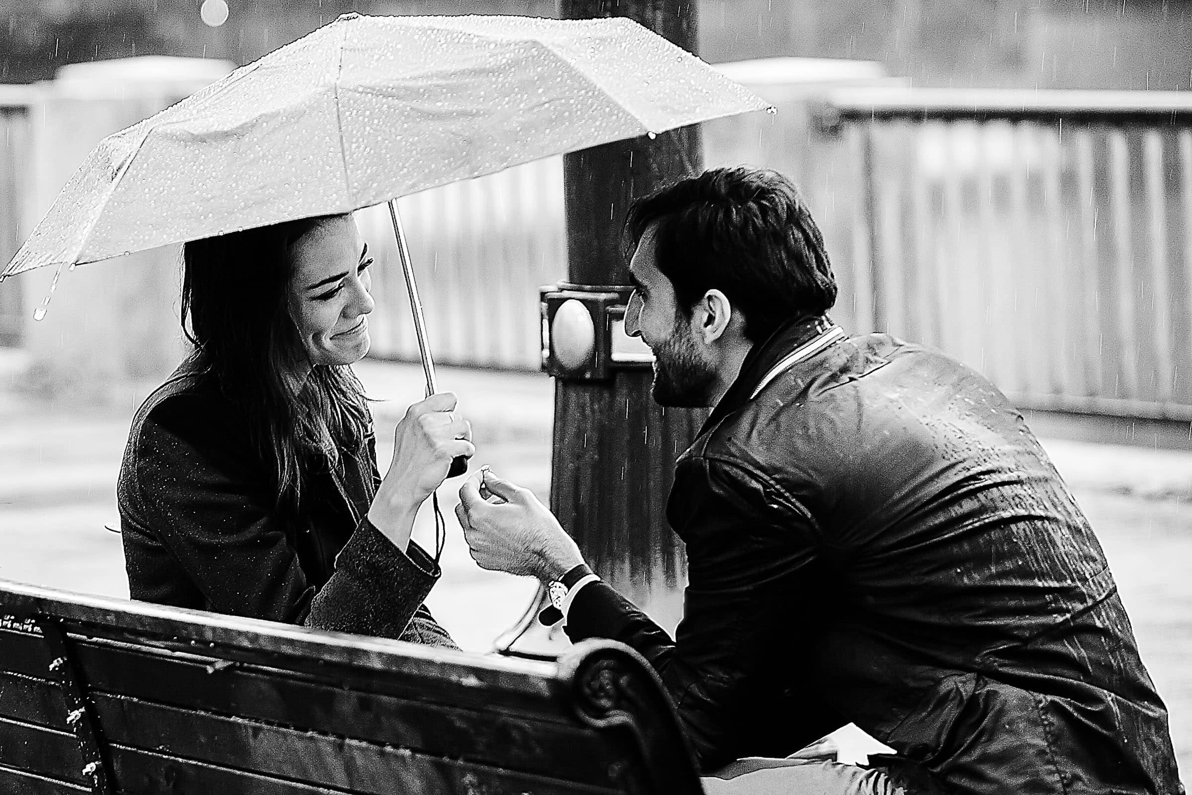 A powerful black and white photo of a Portland engagement proposal on the Portland waterfront park
