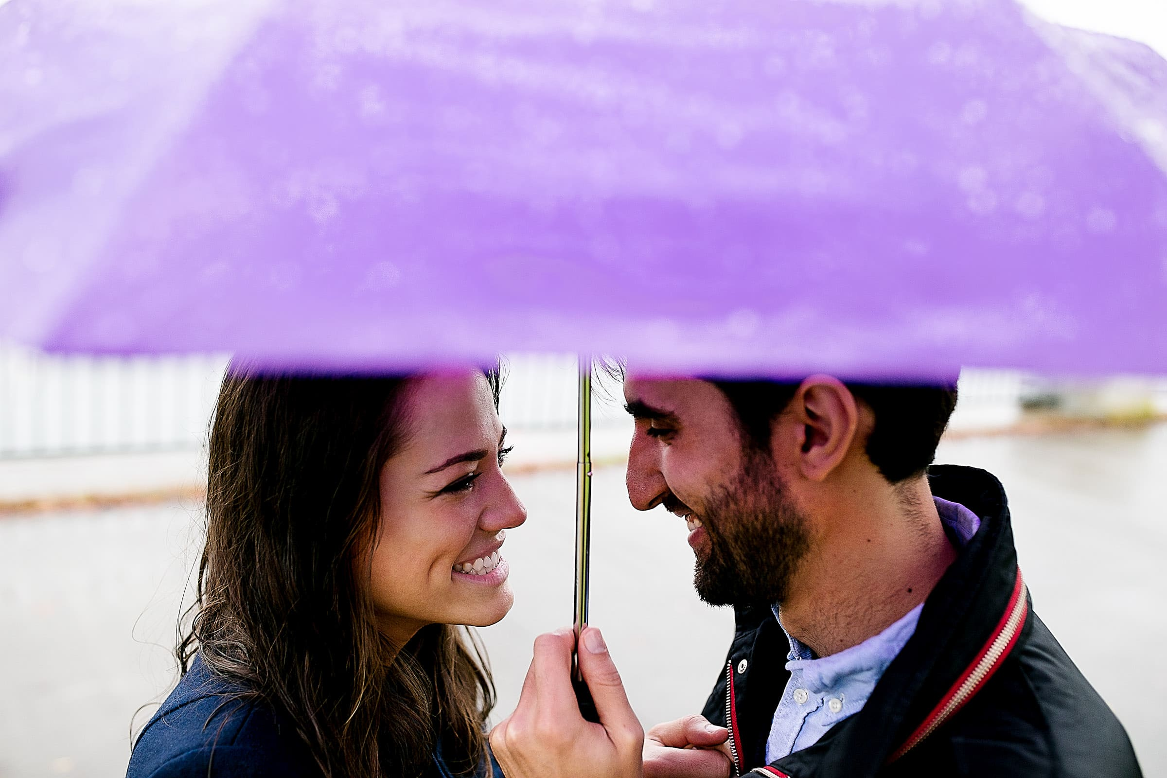 A fun Portland engagement proposal photo under an umbrella on the waterfront park