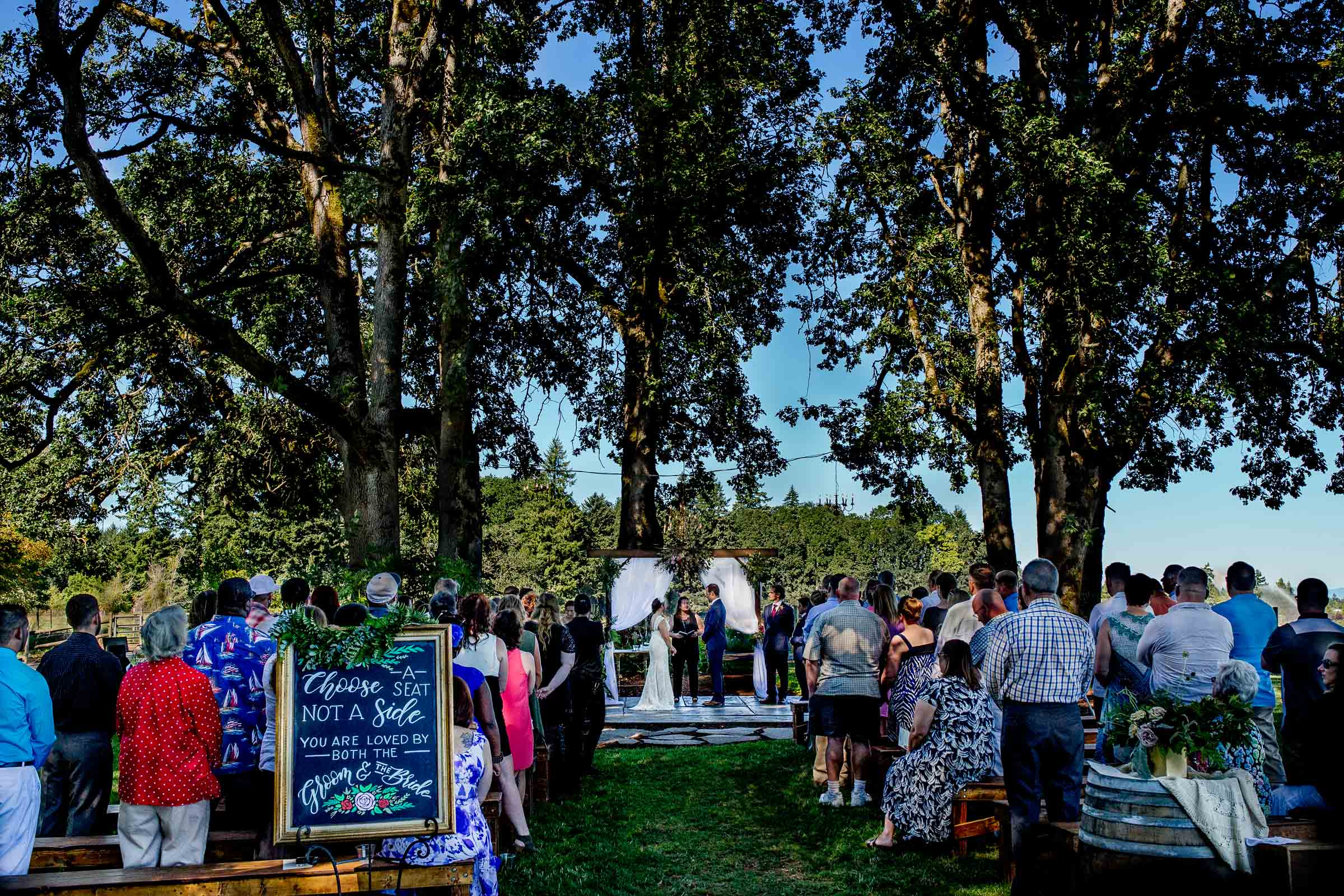 A wide angle view of a Postlewait's Country wedding ceremony located in the heart of the Willamette Valley between Portland and Salem near Aurora, Oregon