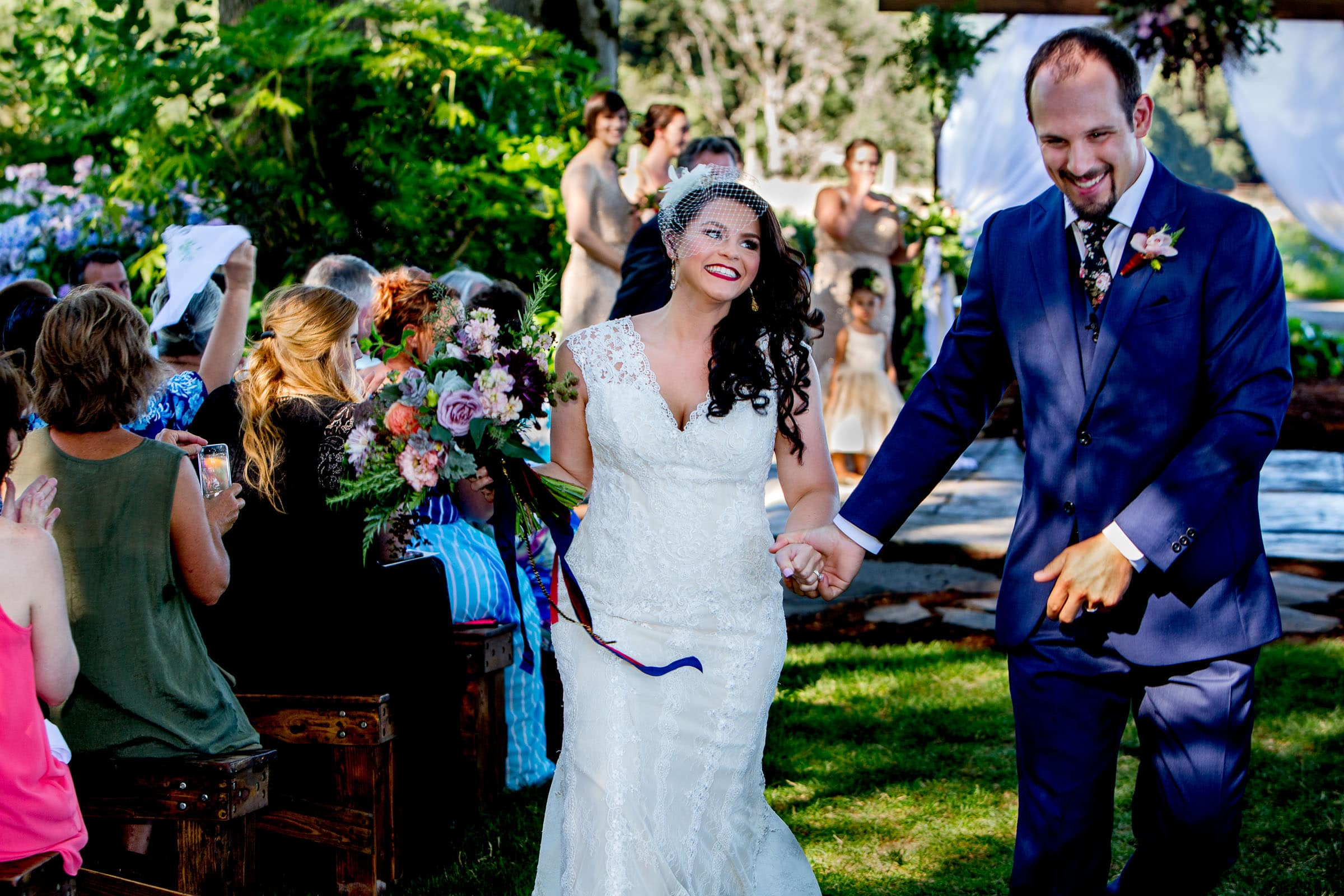 A happy bride and groom exiting their Postlewait's Country wedding located in the heart of the Willamette Valley between Portland and Salem near Aurora, Oregon