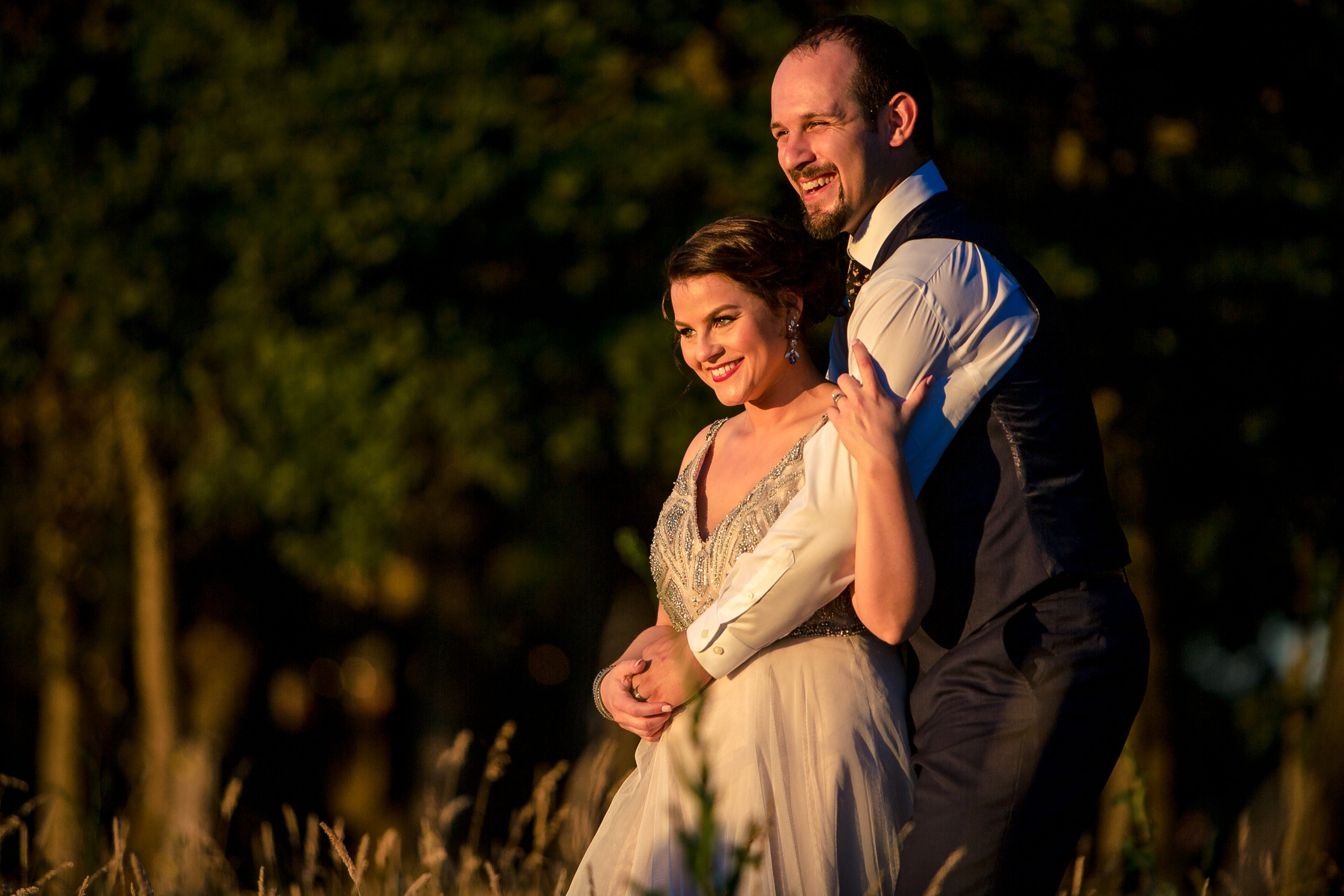 A beautiful bride and groom enjoying sunset during their Postlewait's Country wedding located in the heart of the Willamette Valley between Portland and Salem near Aurora, Oregon