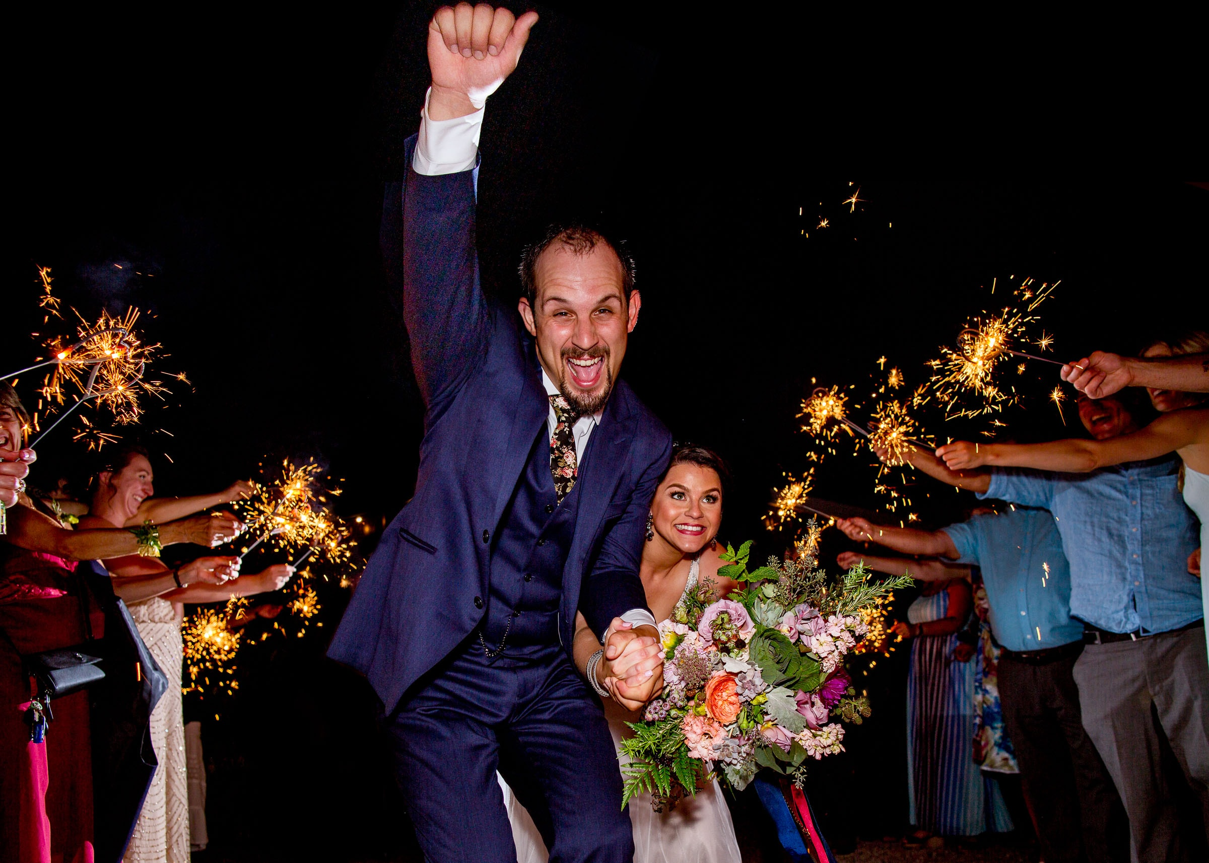 A bride and groom exiting with sparklers during their Postlewait's Country wedding located in the heart of the Willamette Valley between Portland and Salem near Aurora, Oregon