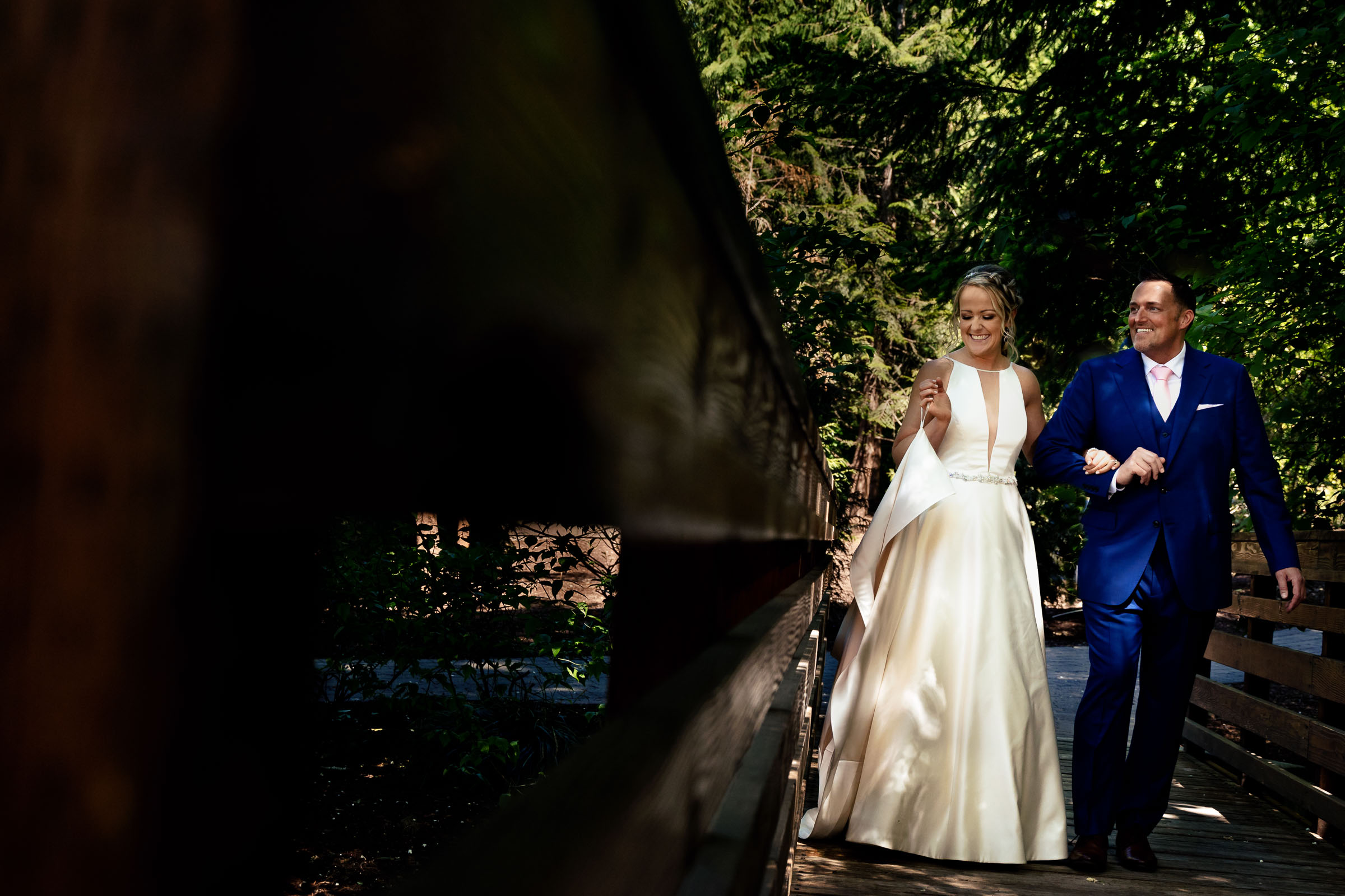 Bride and groom laughing together moments before their Abernethy Center Portland Wedding in Oregon City