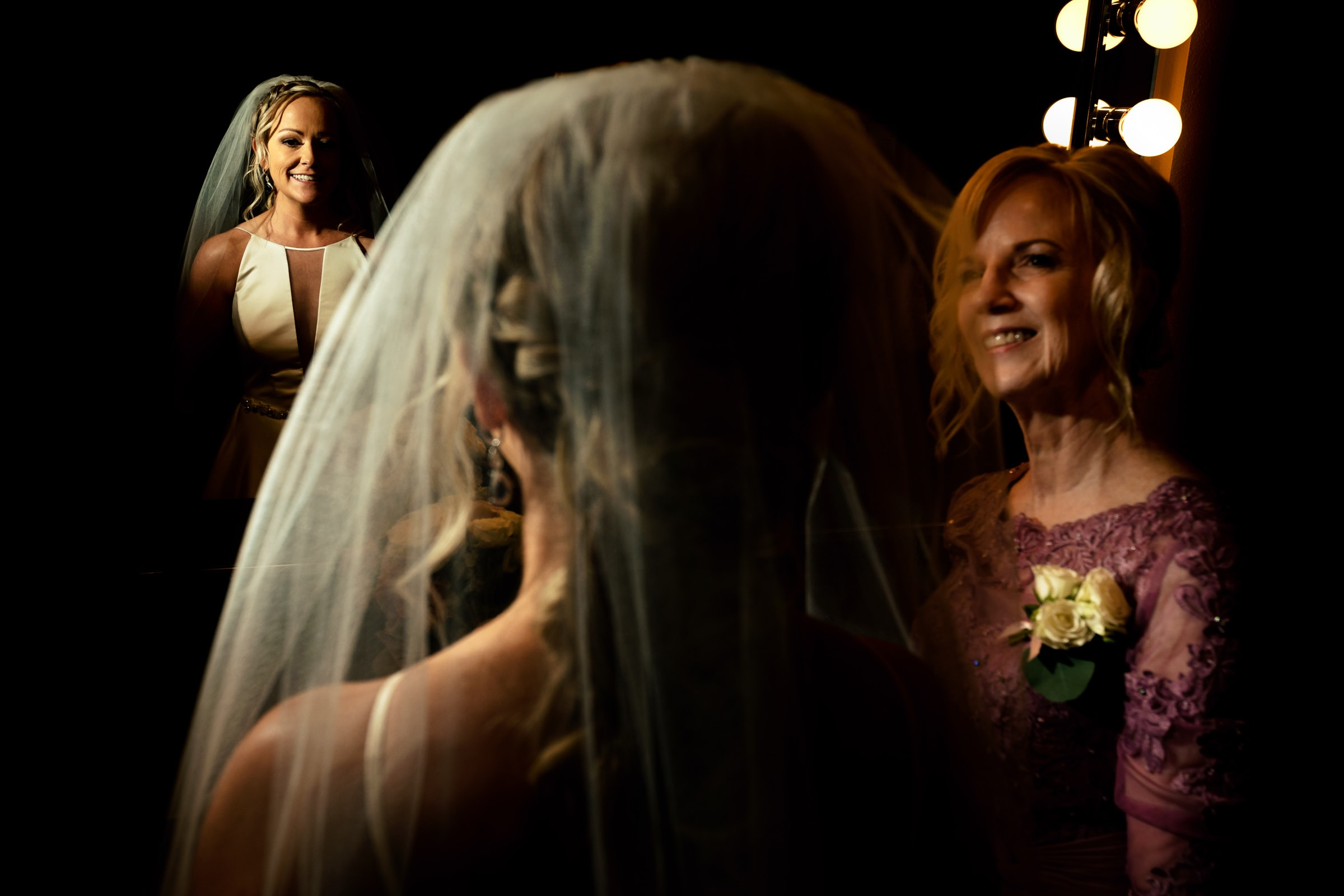 Bride and mother putting veil on moments before an Abernethy Center Portland Wedding in Oregon City