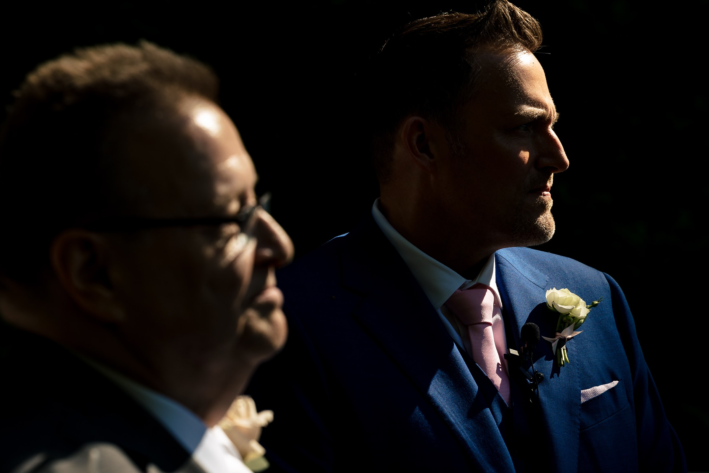 Dramatic photo of groom and officiant looking toward bride during an Abernethy Center Portland Wedding in Oregon City