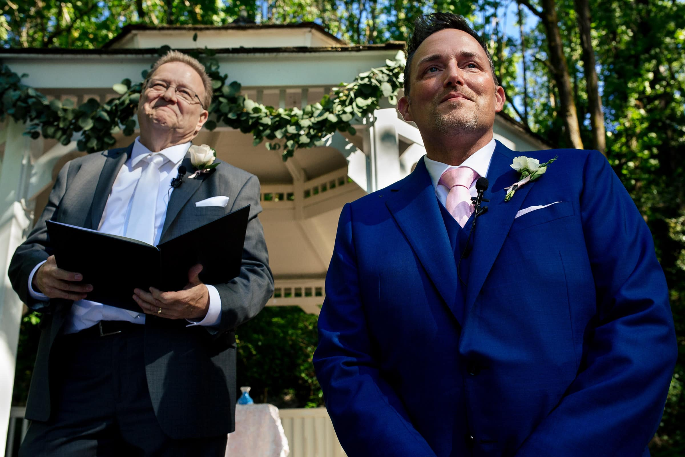 Groom and officiant looking at a bride walking in during an Abernethy Center Portland Wedding in Oregon City