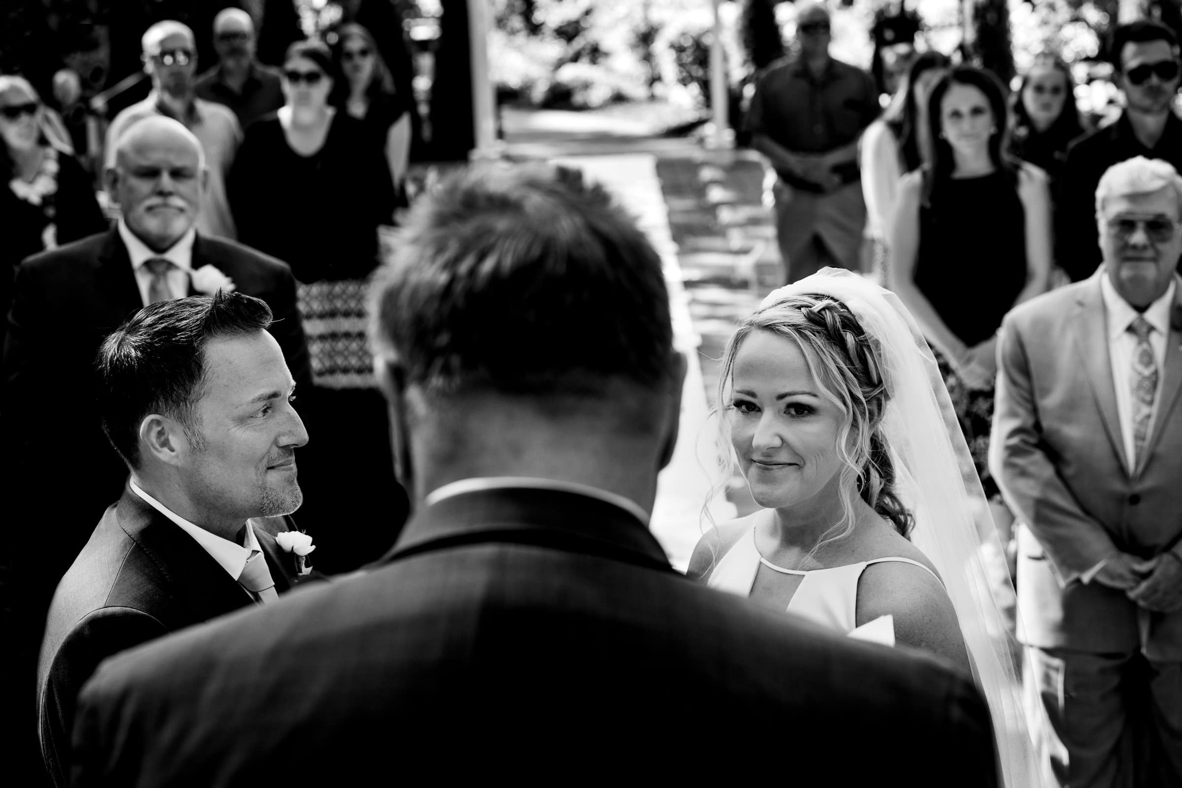 Bride and groom exchanging vows during their Abernethy Center Portland Wedding ceremony in Oregon City