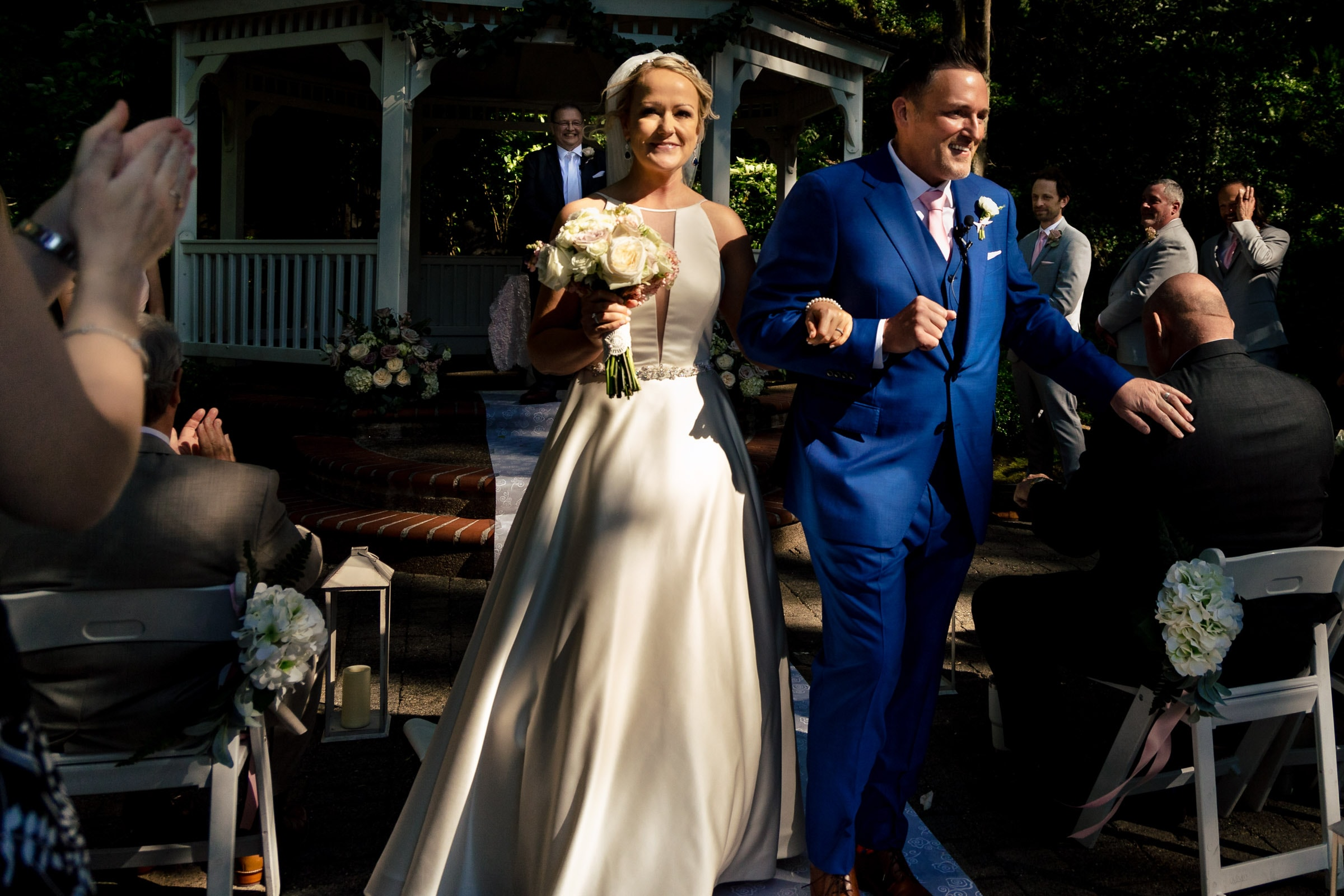 Bride and groom exiting their Abernethy Center Portland Wedding in Oregon City