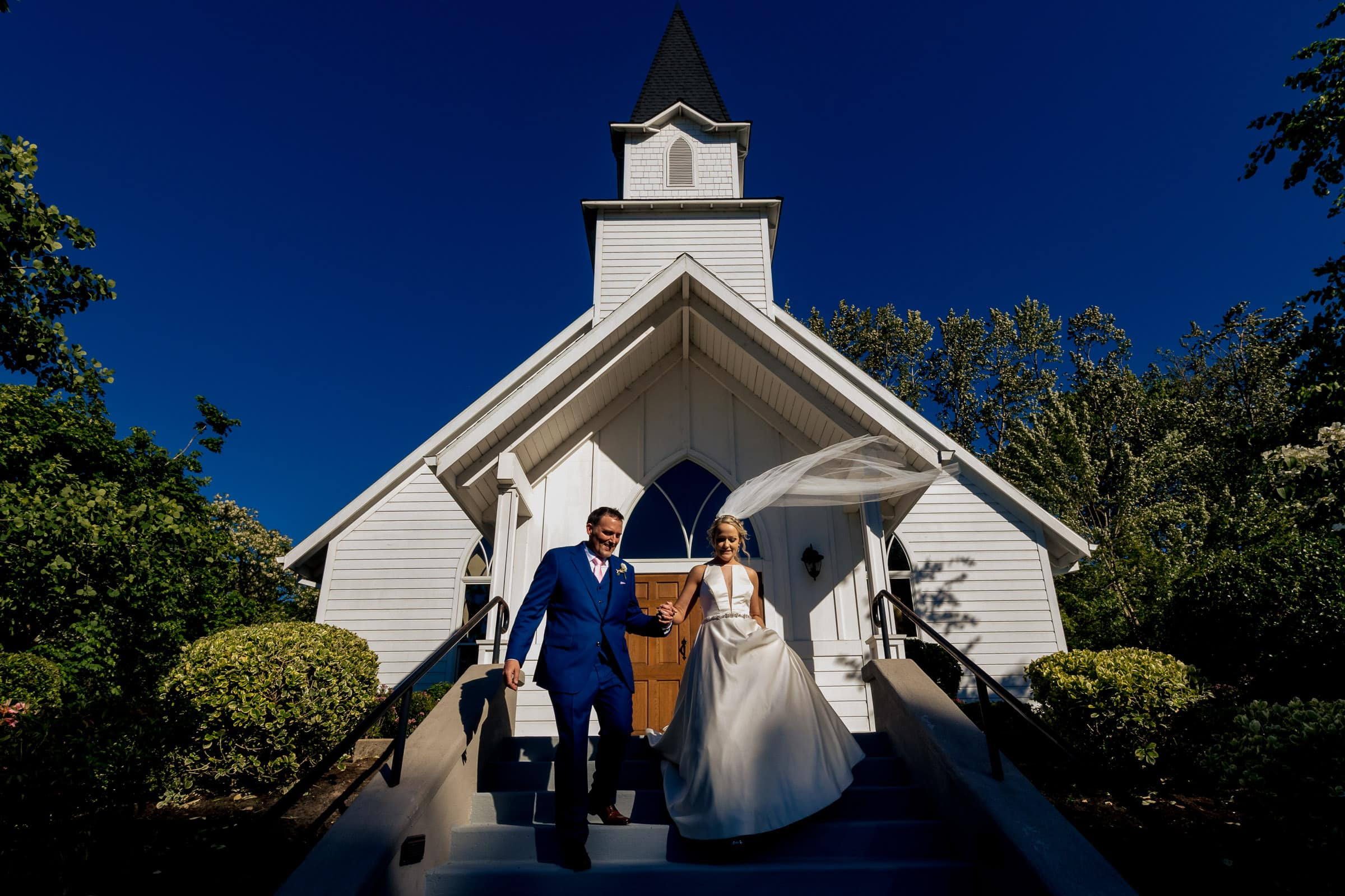 Bride and groom walking down from the chapel during their Abernethy Center Portland Wedding in Oregon City