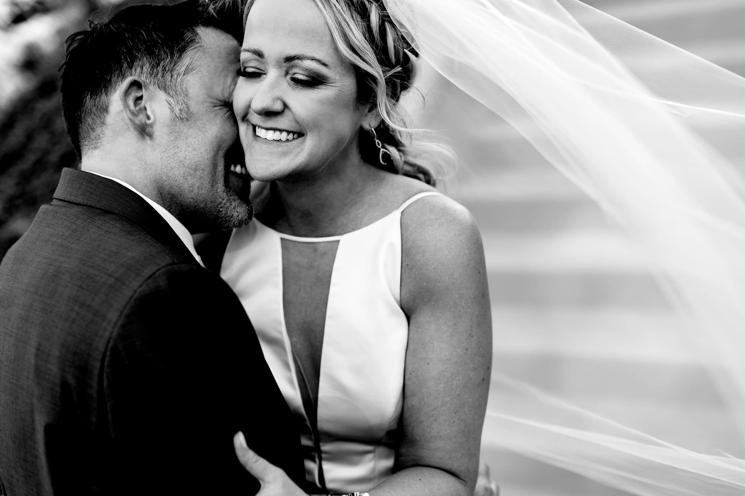 Bride and groom embracing each other just after their Abernethy Center Portland Wedding ceremony in Oregon City