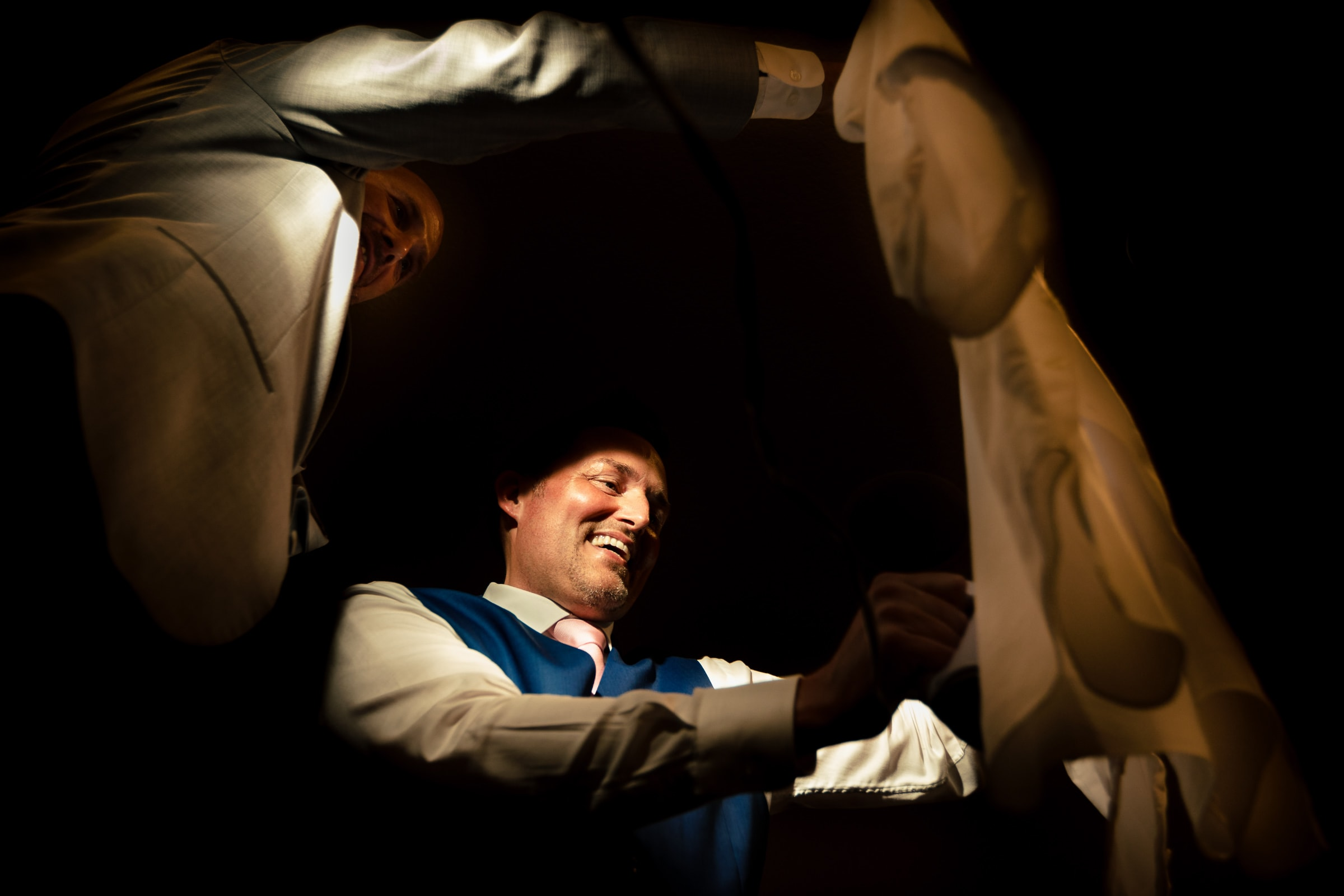 Groom steaming a shirt while getting ready for his Abernethy Center Portland Wedding in Oregon City