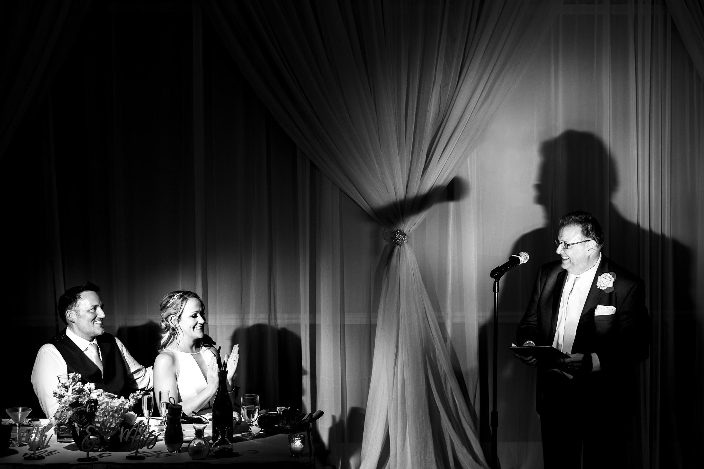 Dramatically lit fathers speech during an Abernethy Center Portland Wedding reception in Oregon City