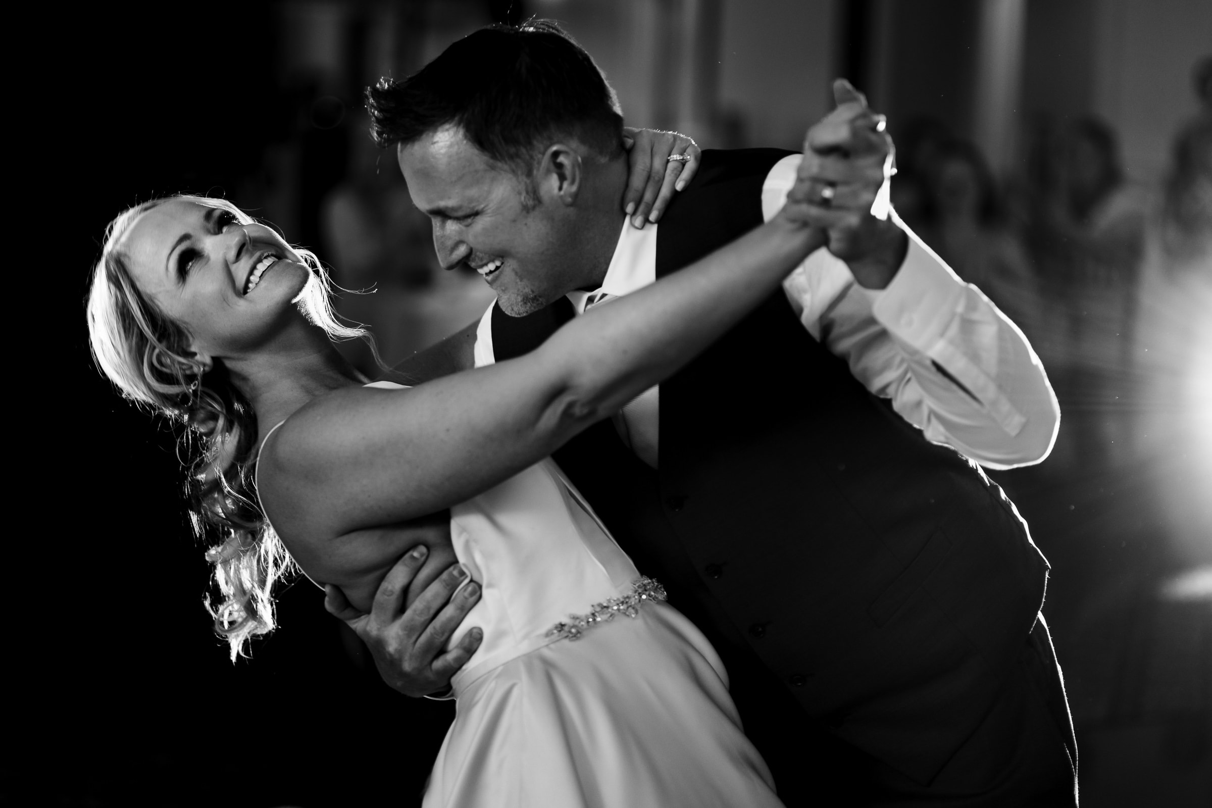 Bride and groom embracing during their dance at their Abernethy Center Portland Wedding reception in Oregon City