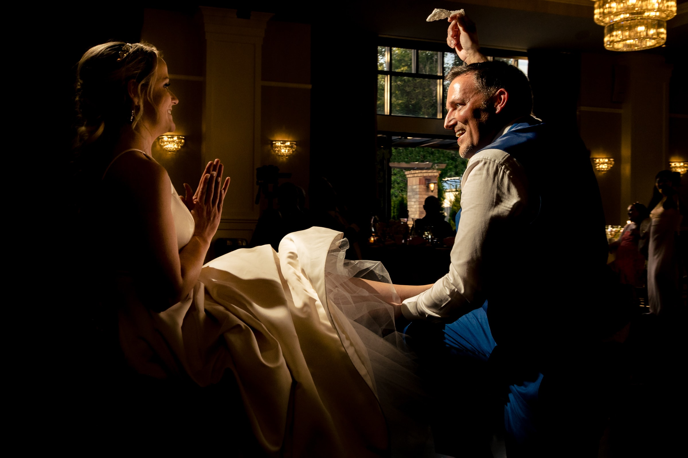 Groom celebrating having the corset during their Abernethy Center Portland Wedding reception in Oregon City