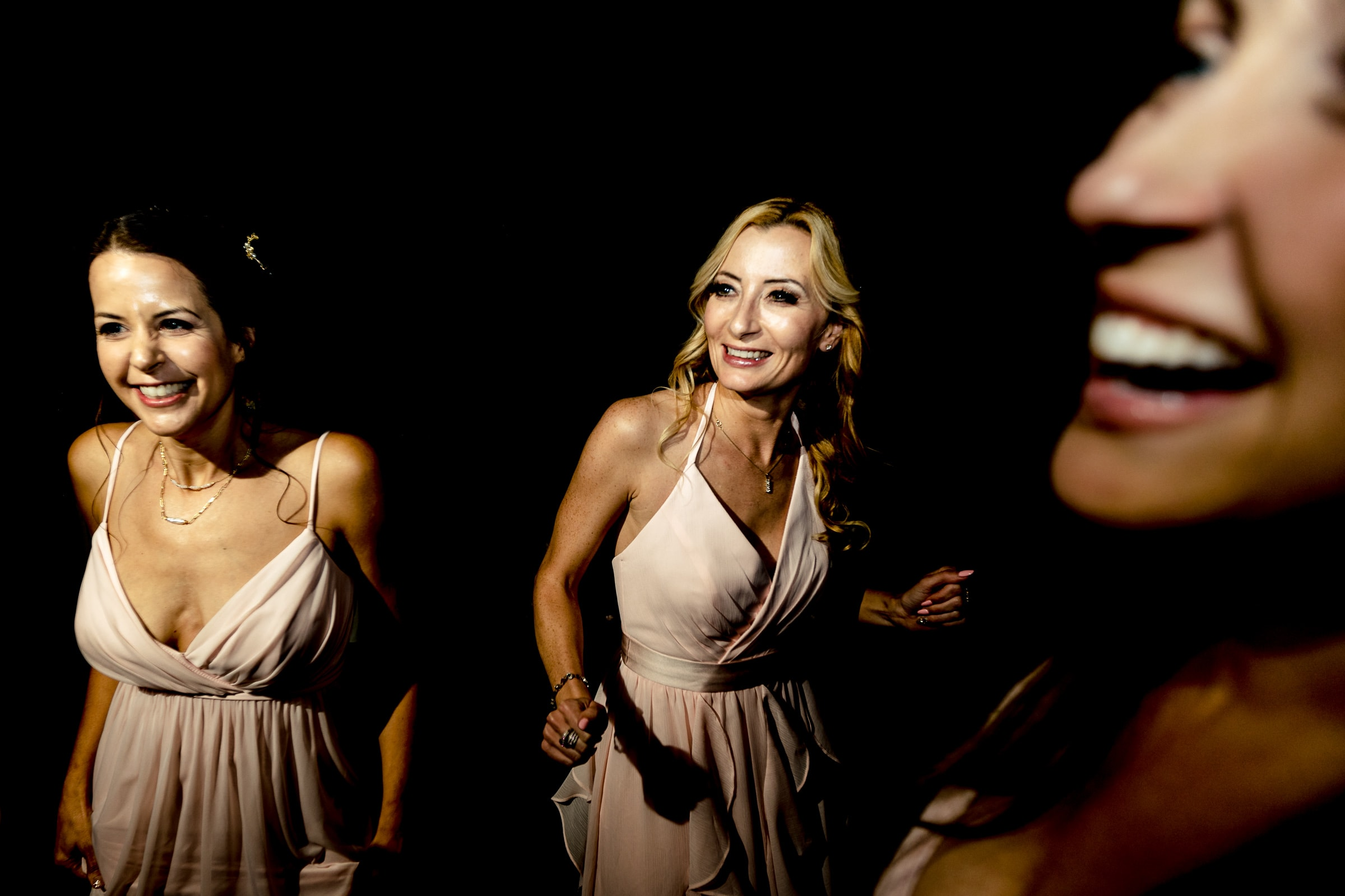 Bridesmaids laughing on the dance-floor during an Abernethy Center Portland Wedding reception in Oregon City