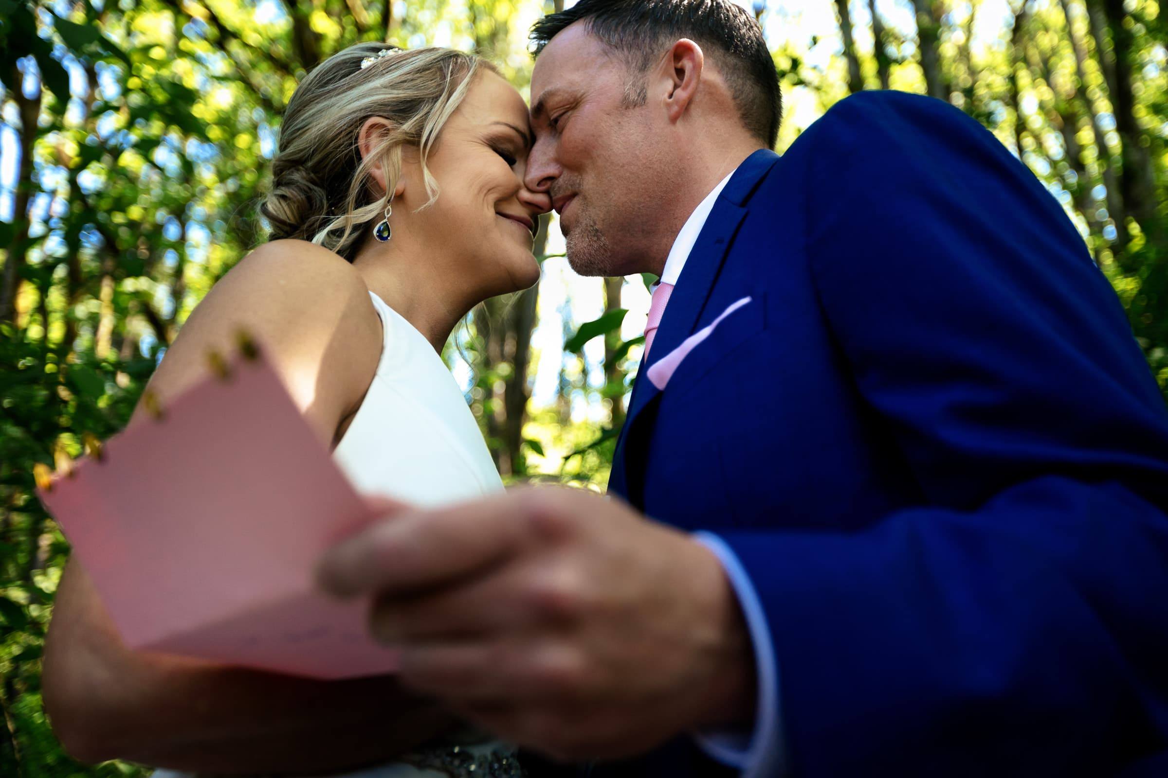 Bride and groom reading intimate letters to each other moments before their Abernethy Center Portland Wedding ceremony in Oregon City