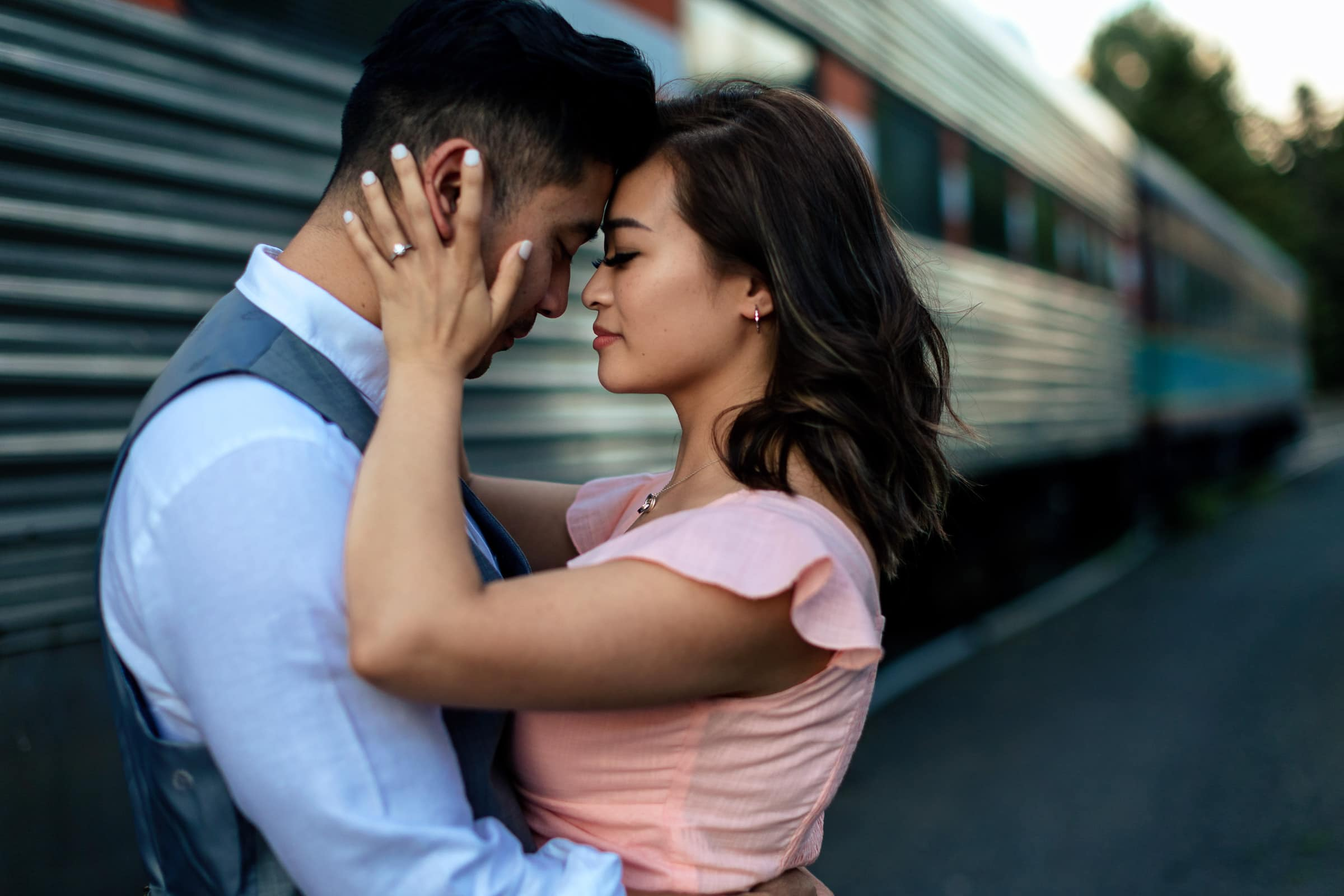 An intimate photo of a couple near a train in Hood River during their Lavender Valley Engagement Photos
