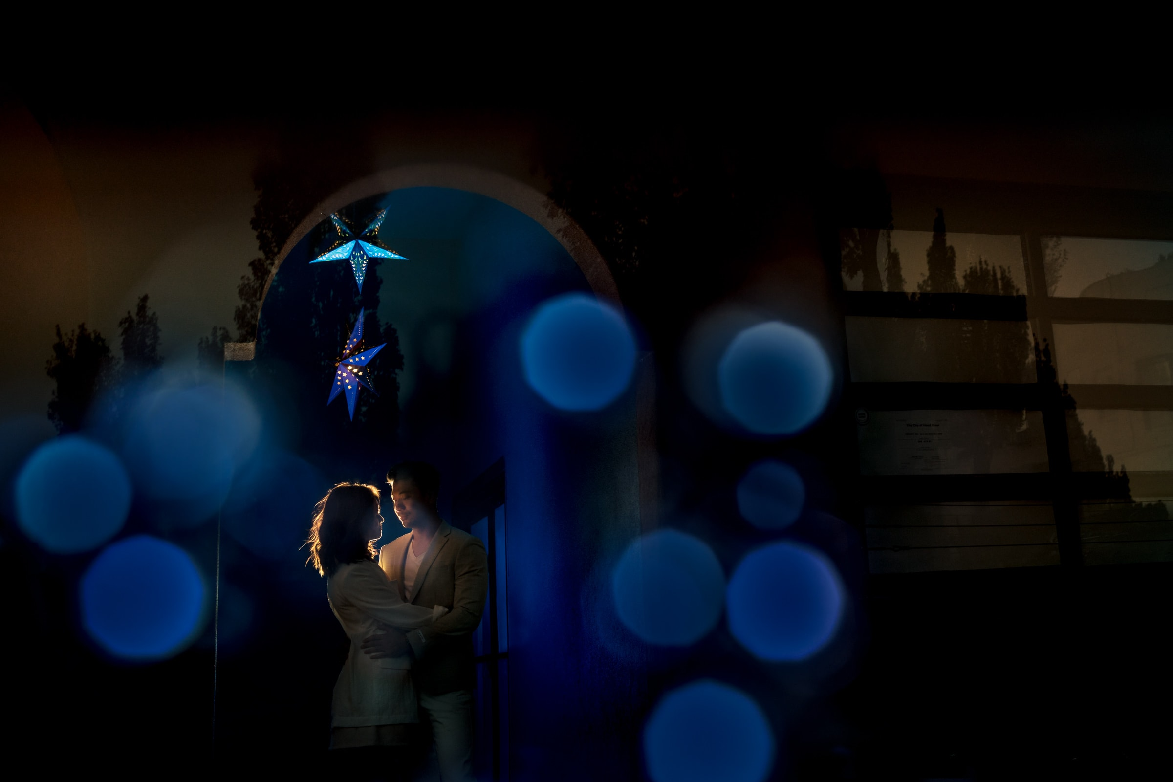 A mysterious and beautiful night photo of a couple outside in an arch way in Hood River during their Lavender Valley Engagement Photos