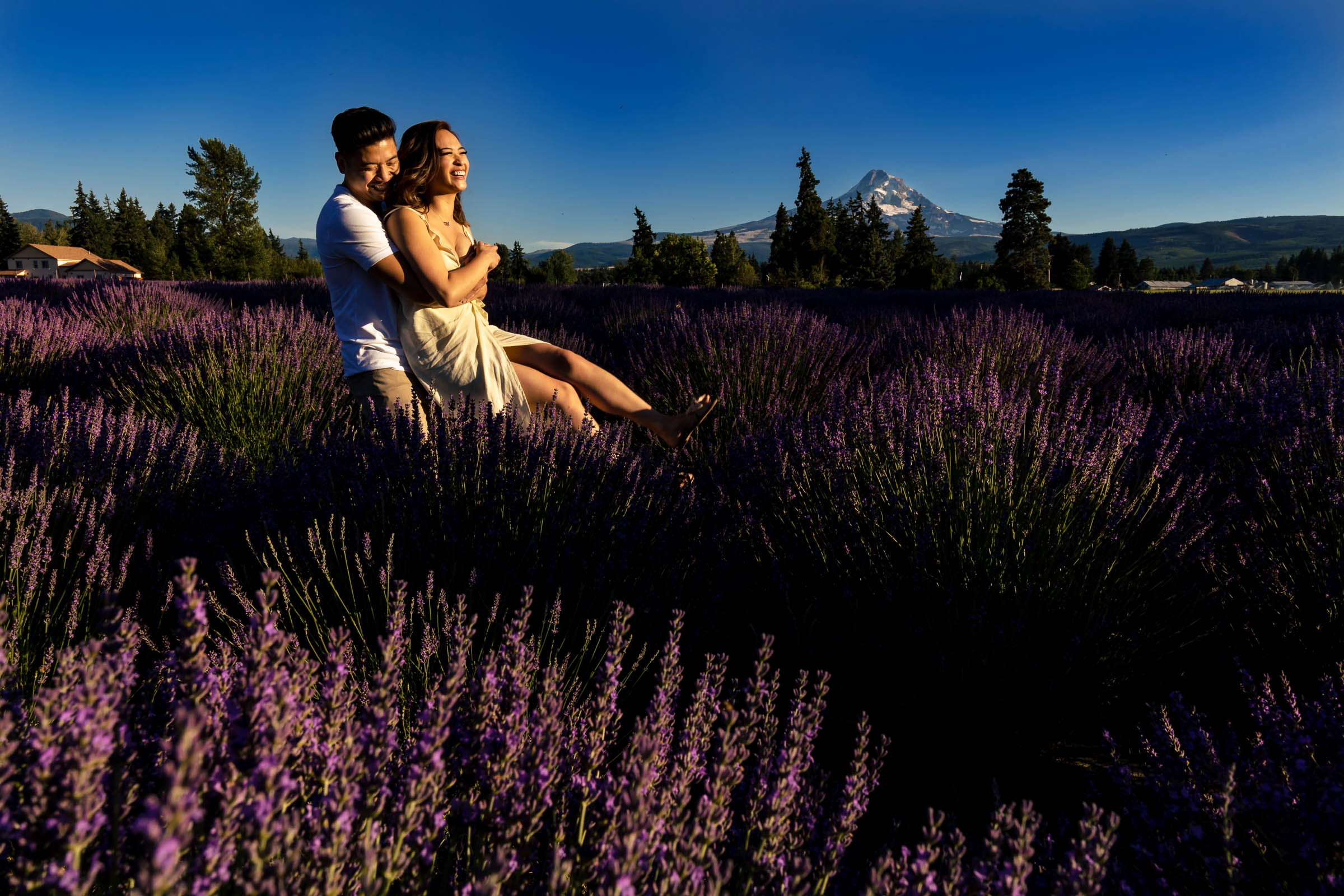 A fun and happy couple hugging during their Lavender Valley Engagement Photos