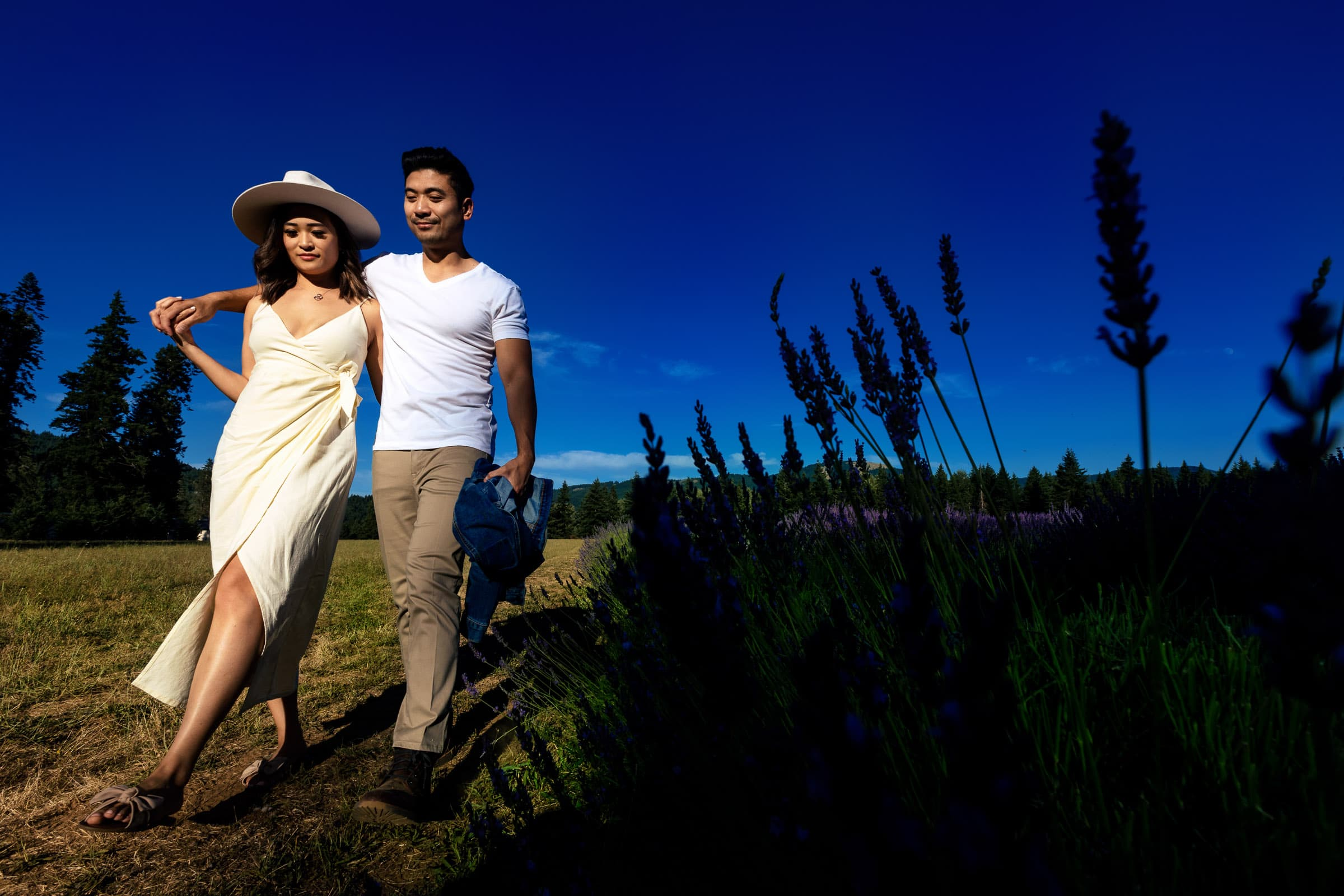 A couple walking together during their Lavender Valley Engagement Photos