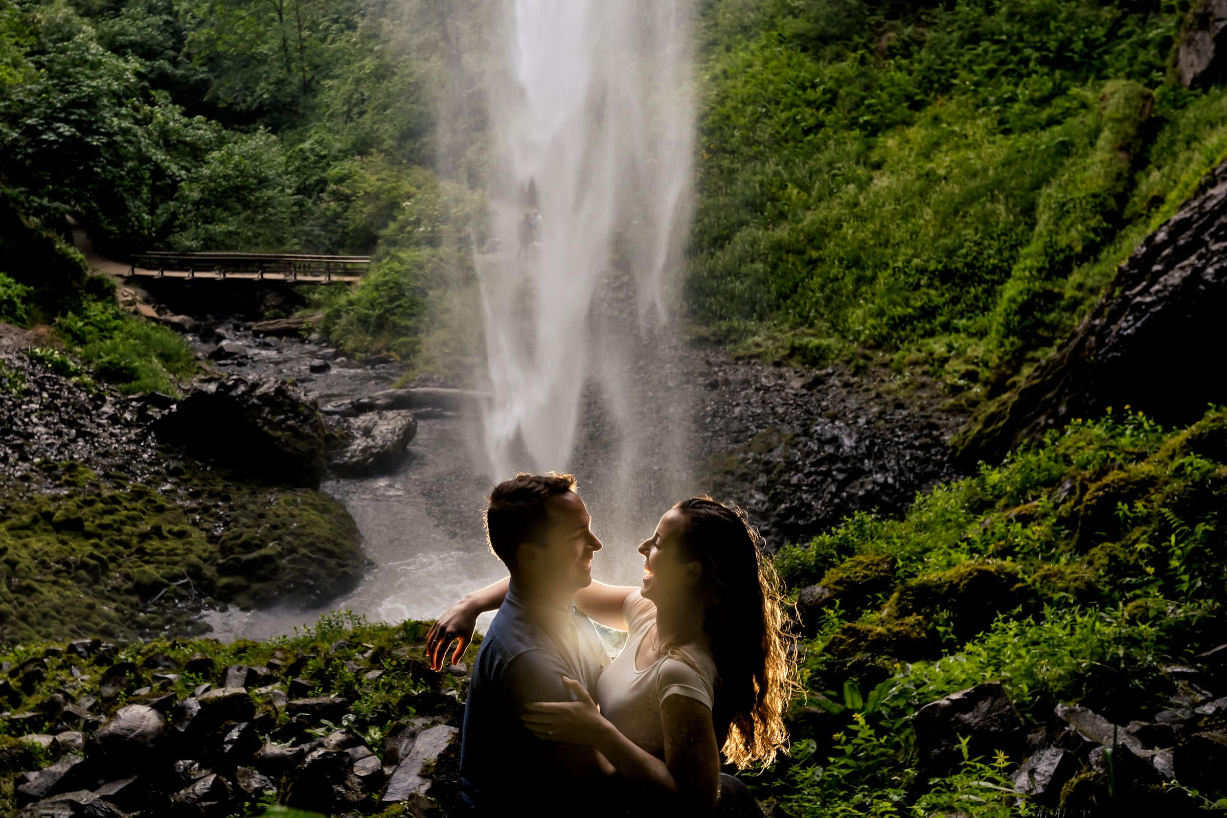Stunning photo of a couple under Latourell Falls during their engagement photos moments after their real proposal moment. Best Engagement Photography Locations in Portland. Latourell Falls Engagement Photos by Jos and Tree, portland wedding photographers.