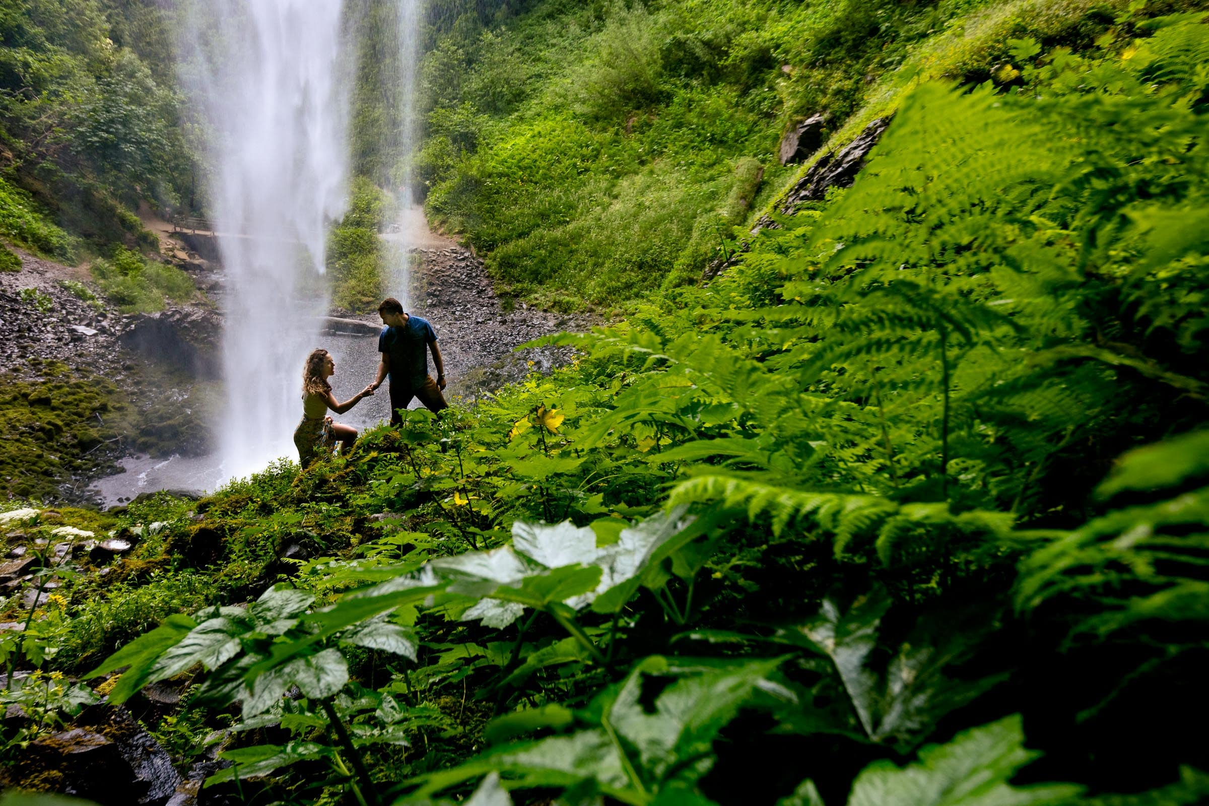 Engagement photos of a couple walking under Latourell Falls moments after their real proposal moment. Best Engagement Photography Locations in Portland. Latourell Falls Engagement Photos by Jos and Tree, portland wedding photographers.