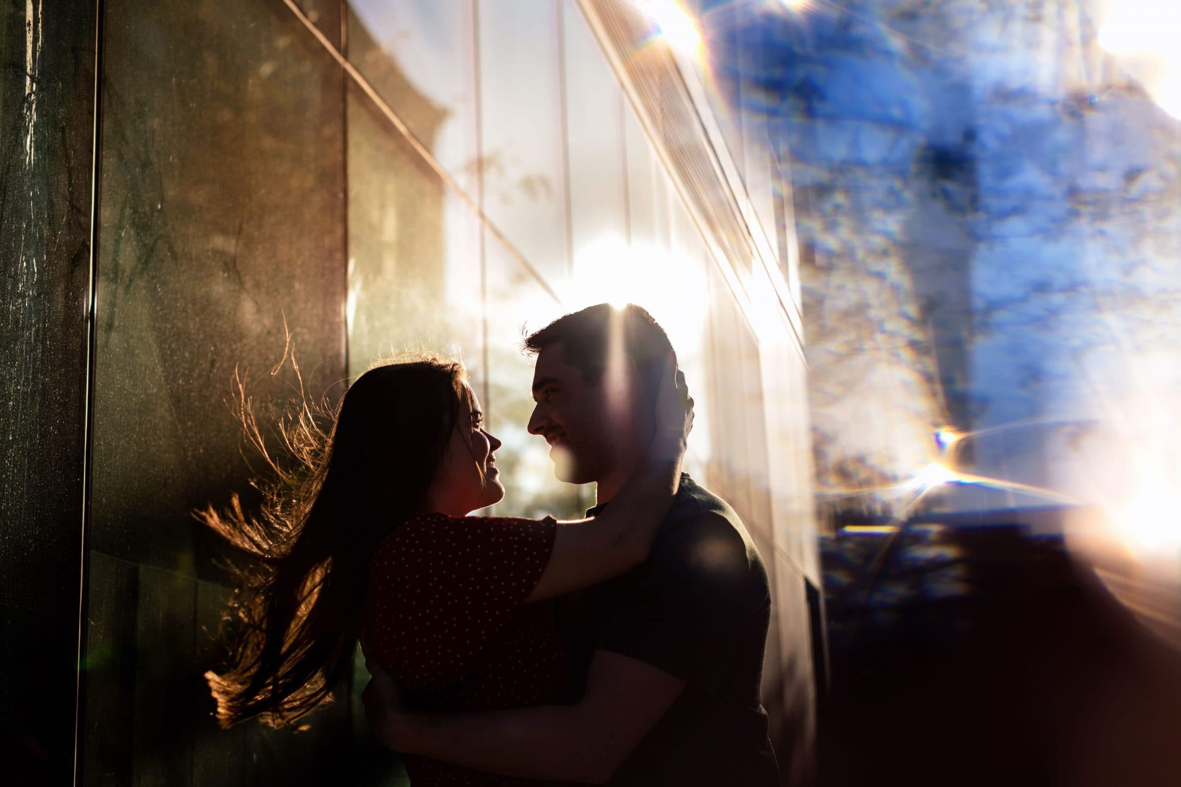 A dramatic lit photo of a couple in Portland for their Tilikum Bridge engagement photos